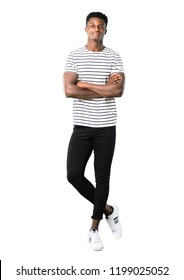 Full body of Dark skinned man with striped shirt keeping the arms crossed in frontal position. Confident expression on white background
