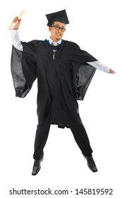 Full body excited Asian male university student in graduation gown jumping isolated on white background