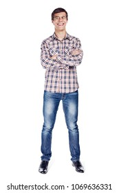 Full body front view portrait of laughing young man with crossed arms on his chest wearing metal frame glasses, checkered shirt, blue jeans and black shoes isolated on white background