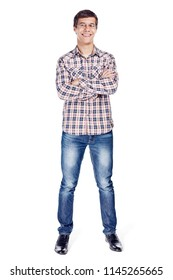 Full body front view portrait of smiling young man with crossed arms on his chest wearing metal frame glasses, checkered shirt, blue jeans and black shoes isolated on white background