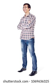 Full body half turn view portrait of smiling young man with crossed arms on his chest wearing metal frame glasses, checkered shirt, blue jeans and black shoes isolated on white background