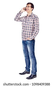 Full body half turn view portrait of smiling young man talking on mobile phone wearing metal frame glasses, checkered shirt, blue jeans and black shoes isolated on white background