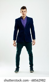 Full body of a handsome young brunette man wearing  shirt and dark jacket and jeans