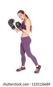 A full body image of a woman boxing and in workout outfits standing