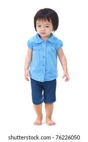 Full body of little Asian girl walking on white background