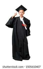 Full body of Little boy graduating intending to realizes the solution on isolated white background