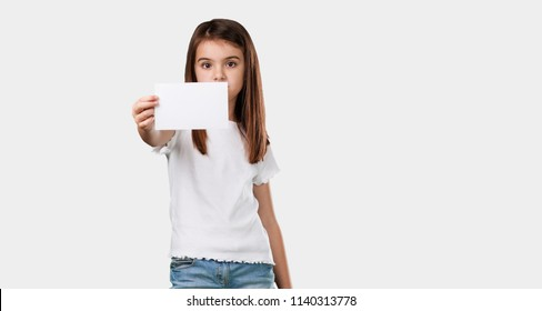 Full body little girl smiling confident, offering a business card, has a thriving business, copy space to write whatever you want