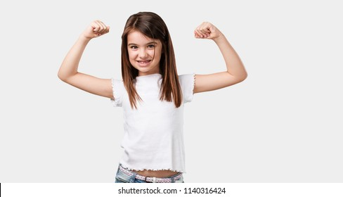 Full body little girl very happy and excited, raising arms, celebrating a victory or success, winning the lottery