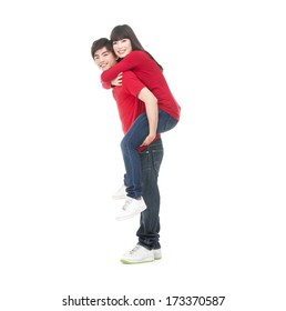 Full body man carrying girlfriend on his back