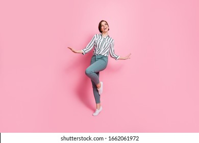 Full body photo of charming pretty girlish girl feel fun on spring holidays enjoy wear modern clothing isolated over pink color background