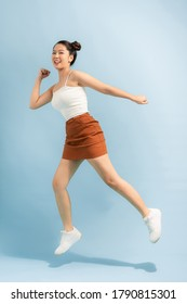 Full body photo of cheerful excited energetic girl jump enjoy spring free time holiday weekend isolated over bright color background