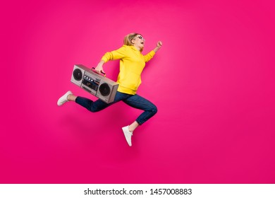 Full body photo of crazy lady jumping high rushing to student party wear casual outfit isolated pink background