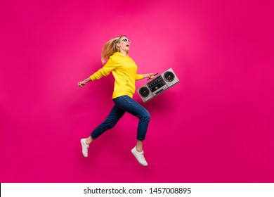Full body photo of crazy lady jumping high walking to student party wear casual outfit isolated pink background