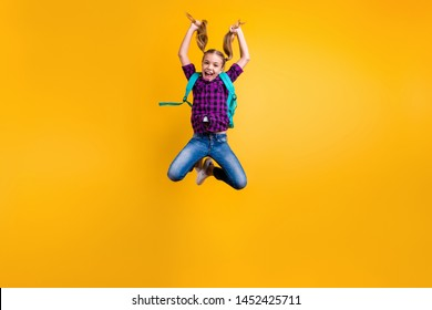 Full body photo of little pupil jump high finally holidays wear casual checkered shirt jeans denim isolated yellow background