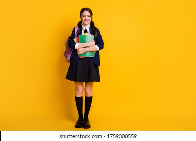 Full body photo of positive a-level student girl hold hand note books ready learn courses academic material wear uniform shoes isolated bright shine color background