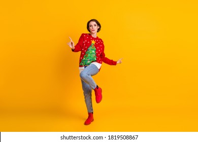 Full body photo of positive energetic girl in christmas tree decor pullover dance on x-mas tradition masquerade party isolated over bright shine color background