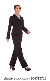 full body picture of a business woman walking isolated over a white background
