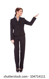 full body picture of a business woman presenting something imaginary over white background