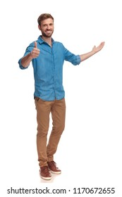 full body picture of a casual man presenting and making the ok sign on white background