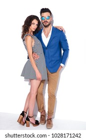 full body picture of an embraced couple posing in studio