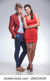 full body picture of a fashion couple posing in studio