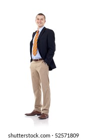 full body picture of a smiling business man standing with hands in pockets