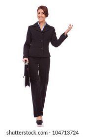 full body picture  of successful business woman walking with a briefcase and welcoming - White background