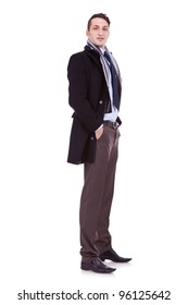 full body picture of a young business man with winter coat and with his hands in his pockets, over white background
