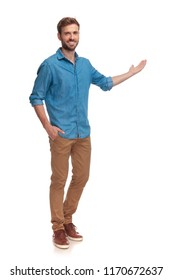 full body picture of a young casual man presenting something on white background