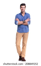 full body picture of a young casual man with hands crossed smiling on white background