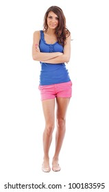 Full body picture of a young woman standing with her arms crossed on white background