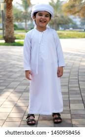 Full body portrait of Arab student wearing traditional Muslim gulf kandura with head scarf
