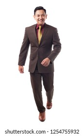 Full body portrait of Asian businessman in formal suit isolated on white. Front view of successful man gentleman business person standing walking