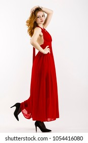 Full body portrait with a beautiful redheaded woman