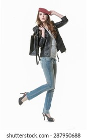 Full body Portrait of a beautiful young woman in jeans with bag posing