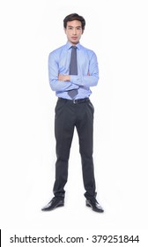 Full body Portrait of businessman standing with crossed arms