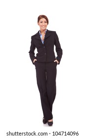 full body portrait of a businesswoman with hands in pockets standing against white background