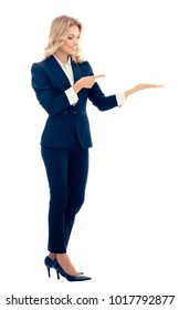 Full body portrait of businesswoman, showing something, some product or blank copyspace area for advertise slogan or text message, isolated over white background. Blond model in business concept.