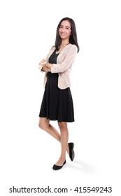 Full body portrait of cheerful young Asian woman in casual business dress standing over white studio background