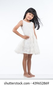 Full body portrait of a child smiling on white background