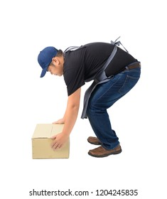 Full Body portrait of delivery man in Black shirt and apron. he lifting heavy weight boxes against having a backache isolated on the white background with clipping path