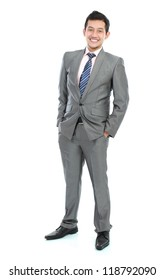 full body portrait of handsome young business man in suit