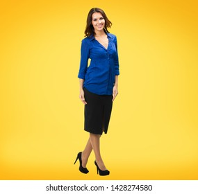 Full body portrait of happy smiling business woman in blue confedent clothing, isolated over yellow orange background. Brunette dark heared model at studio. Copy space.