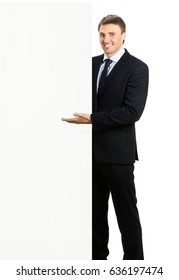 Full body portrait of happy smiling young businessman showing blank signboard, isolated over white background. Success in business, job and education concept shot.