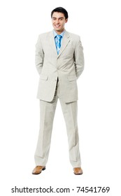 Full body portrait of happy smiling businessman, isolated on white background
