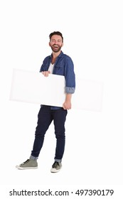 Full body portrait of mature man holding blank billboard and smiling over white background