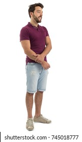 Full body portrait. Nice guy. Beautiful and bearded person. He is wearing a magenta polo shirt and shorts jeans. White background, isolated.