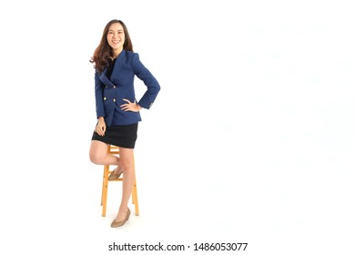 Full body portrait photo of young beautiful Asian woman in formal suit dressing with confident looking on white background studio shot.