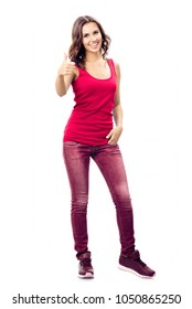 Full body portrait of smiling beautiful young woman in casual smart red clothing, showing thumbs up gesture, isolated over white background
