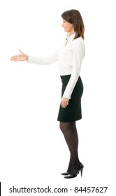 Full body portrait of smiling business woman giving hand for handshake, isolated on white background